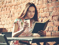 Girl with coffee reading book Royalty Free Stock Images