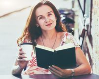 Girl with coffee reading book Stock Photography