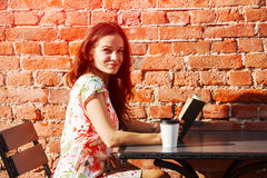 Girl with coffee reading book Stock Photo