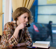 Girl at coffee shop Stock Photo