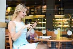 Girl at the coffee shop Stock Photos