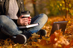Girl with coffee sitting in park Royalty Free Stock Photo