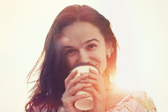 Girl with coffee in sun Royalty Free Stock Photos