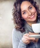 Girl with coffee or tea. Beautiful Girl With Cup of Coffee or Tea Royalty Free Stock Photography