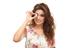 Girl with a coin. Girl holds a coin near an eye Royalty Free Stock Photos