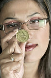 Girl with coin royalty free stock image
