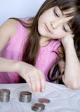 Girl with coins Royalty Free Stock Image