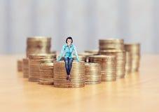 Girl on coins Stock Photos