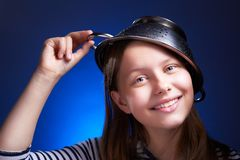 Girl with a colander on her head Stock Photography