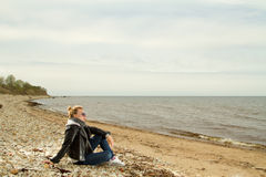 Girl cold sea Stock Photo
