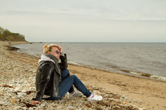 Girl cold sea Stock Image