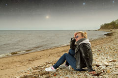 Girl cold sea Stock Images