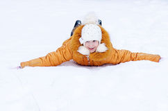 The girl лежин on cold snow Stock Photo