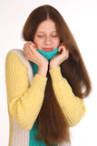 Girl cold and uncomfortable. She has a toothache. Royalty Free Stock Photos