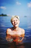 Girl in cold water sea shoked. Blonde girl in cold water sea shoked and smiling Stock Photos