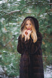 Girl cold in winter forest Royalty Free Stock Image