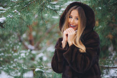 Girl cold in winter forest Stock Photo