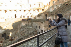 Girl in coliseum Stock Images
