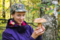 Girl collect cep boletus Royalty Free Stock Images