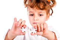 Girl collect puzzle Royalty Free Stock Photos