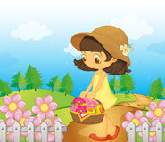 A girl collecting flowers Stock Image