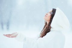 Girl collecting snowflakes Royalty Free Stock Photo