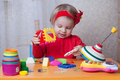 Girl collecting sorter at table Royalty Free Stock Photos