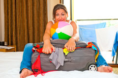 Girl collecting suitcases Sea Royalty Free Stock Photography