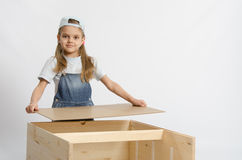 Girl collects the back cover of chest Royalty Free Stock Images