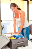 Girl collects gently suitcase Sea Royalty Free Stock Image