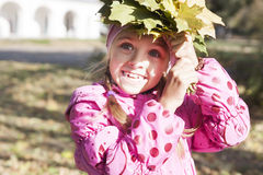 Girl collects leaves Stock Images