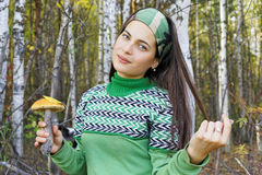 Girl collects mushrooms in the forest Stock Photography