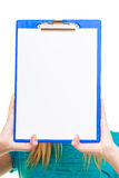 Girl college student holds clipboard with empty blank Stock Image