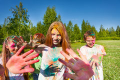 Girl on color festival smeared with colored powder Stock Photo