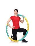 Girl with color hula hoop Stock Image