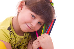 Girl with color pencils Royalty Free Stock Image