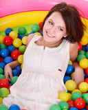 Girl in in colored ball. Stock Image