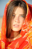 Girl in colored cloak. Portrait of a beautiful girl in colored cloak Stock Images