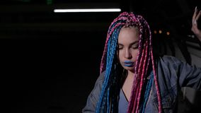 Girl with colored dreadlocks is dancing stock video footage