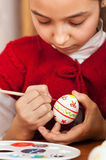 Girl colored Easter eggs Stock Photography