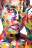 Girl with colored face painted. Art beauty image Royalty Free Stock Image