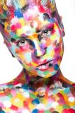 Girl with colored face painted. Art beauty image. Stock Photo