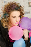 Girl with colored hair. Girl with coloed hair, smile and balloons Stock Images