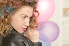 Girl with colored hair. Girl with coloed hair, smile and balloons Stock Photo