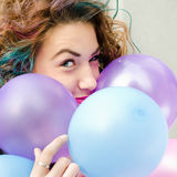 Girl with colored hair. Girl with coloed hair, smile and balloons Stock Image