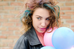 Girl with colored hair. Girl with coloed hair, smile and balloons Stock Photography