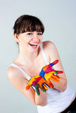 A girl with colored hands Stock Images