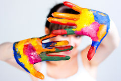 A girl with colored hands Stock Photo