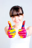 A girl with colored hands Stock Photos