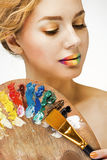 Girl with colored lips with palette Royalty Free Stock Photography